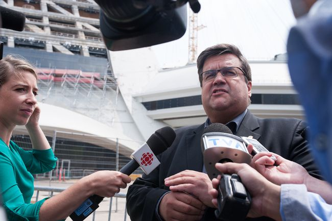 The Mayor of Montreal Denis Coderre speaks to the media as a bus of Haitian asylum seekers from the United States arrives at the Olympic Stadium in Montreal, Quebec on August 3, 2017. CATHERINE LEGAULT/Getty Images