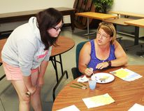 Sherry Greipentrog and Jana Rejcha discuss the finer points of creating the perfect flower during the Brain Injury Association of Sarnia-Lambton's expressive art workshop on Aug. 2. CARL HNATYSHYN/SARNIA THIS WEEK