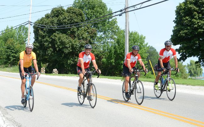 George Vanderkuur, left, and other riders take part in the Sea to Sea Ride to Help End Poverty near Owen Sound on Tuesday. (Rob Gowan The Sun Times)