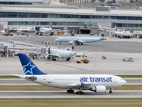 Air Transat plane at Toronto's Lester B. Pearson Airport, Thursday October 21, 2010. (Peter J. Thompson/National Post) (For Story by Scott Deveau/National Post/Financial Post) //NATIONAL POST STAFF PHOTO