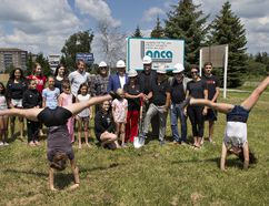 Showing their excitement for the new home of the Brantford Gymnastics Academy, Maya Tiffany (left) and Sara Luciani do cartwheels during a ground-breaking ceremony on Tuesday. Lanca Contracting will build the new facility on the Park Road North site where the academy's previous home was destroyed by fire. (Brian Thompson/The Expositor)
