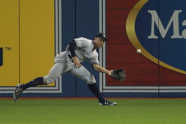 TORONTO, ON - AUGUST 8: Aaron Judge #99 of the New York Yankees makes a running shoestring catch in the seventh inning during MLB game action against the Toronto Blue Jays at Rogers Centre on August 8, 2017 in Toronto, Canada. (Photo by Tom Szczerbowski/Getty Images)