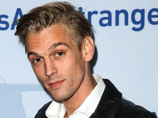 "In this Nov. 9, 2015, file photo, singer Aaron Carter arrives at a premiere of ""Saints & Strangers"" at the Saban Theater in Beverly Hills, Calif. Authorities said Carter and his girlfriend Madison Parker were arrested Saturday, July 15, 2017, on DUI and drug charges in Georgia. (Photo by Rich Fury/Invision/AP, File"