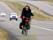 Leo Markus cycles on the 1A Hwy. west of Cochrane after leaving the town on his way to Calgary. The 21 year old German is cycling from Anchorage, Alaska to New York City.