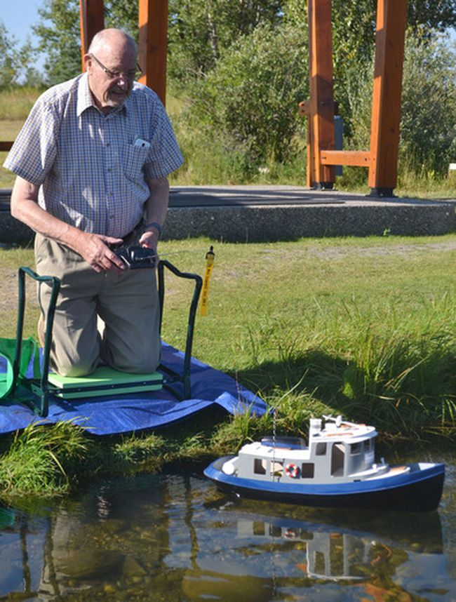 Dave Hardiman sends Tug Boat Annie out into the calm waters of Mitford Pond, where he and his wife are regularly out piloting their remote control boats Sunday mornings. During this time, they encourage people interested in the hobby to come out and try their hand at piloting one of their vessels.