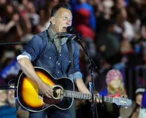 """In this Nov. 7, 2016, file photo Bruce Springsteen performs during a Hillary Clinton campaign event at Independence Mall in Philadelphia. Springsteen plans to make his Broadway debut onstage this fall at the Walter Kerr Theatre in a solo show in which he performs songs from his career, interspersed with readings of his best-selling memoir """"Born to Run."""" """"Springsteen on Broadway"""" begins previews Oct. 3, 2017, ahead of an Oct. 12 opening. (AP Photo/Matt Slocum, File)"""