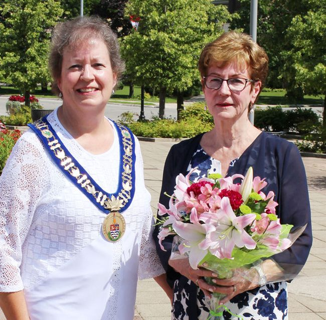 Current Hanover Mayor Sue Paterson, congratulates former Hanover Mayor Kathi Maskell during her paver stone unveiling in Heritage Square on July 29.