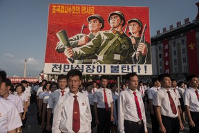 A propaganda poster is displayed during a rally in support of North Korea's stance against the U.S., on Kim Il-Sung square in Pyongyang on August 9, 2017. (KIM WON-JIN/AFP/Getty Images)