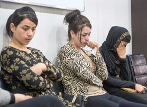 ISIS survivors Suham Haji, left, Samira Hasan, centre, and Saud Khalid, right, sit in the Dohuk Girls and Women Treatment and Support Centre, Wednesday, Feb. 22, 2017 in Dohuk, Iraq. THE CANADIAN PRESS/Ryan Remiorz