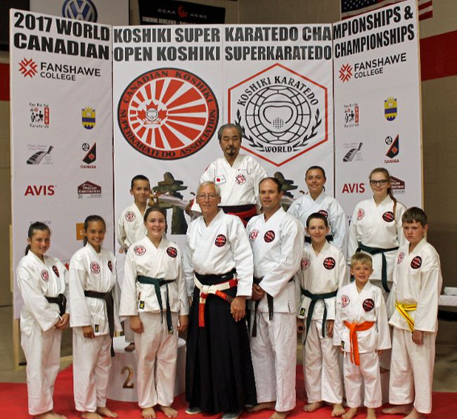 In front, from left, are Paige Rombough, Bryanna Rombough, Keirra Poulin, Shihan Tom Bellazzi, Jim Andrews, Nash Poulin, Wyatt Rombough and Jack Edwards. At back are Mark Menard, Hanshi Hisataka, Kaytlin Andrews and Eva Poulin.