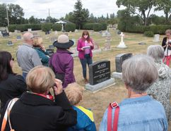 KEVIN RUSHWORTH HIGH RIVER TIMES/POSTMEDIA NETWORK. Olivia Cotton Cornwall, with the Museum of the Highwood, leads the Lasting Legacies tour of the Highwood Cemetery. Pictured above, the tour stops at the grave of former High River mayor Donald Blake.