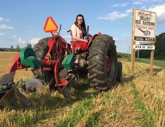 Victoria Kyle, Brant-Six Nations Plowmen's Association's 2017 Queen of the Furrow, demonstrates her skills at the site of the 100th anniversary Brant-Six Nations Plowing Match on Saturday at the farm of Bruce and Sherry Telfer, on Watts Pond Road. (Michael-Allan Marion/The Expositor)