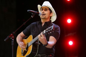 """In this June 2, 2017 file photo, Country music recording artist Brad Paisley performs at the graduation for Barrington High School, at Willow Creek Community Church in South Barrington, Ill. Paisley says years of hosting the Country Music Awards and writing songs with humorous lyrics have - hopefully - prepared him to host his first comedy special, the """"Brad Paisley Comedy Rodeo,"""" which will premiere on Netflix on Tuesday, Aug. 15. (Steve Lundy /Daily Herald via AP, File)"""