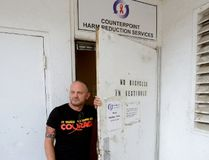 Case Manager Blair Henry shows the back entrance used by clients at the needle exchange program run by the Regional HIV/AIDS Connection in London. (MORRIS LAMONT, The London Free Press)