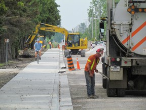This file photo shows road construction in Sarnia during the summer of 2015. Municipalities in Sarnia-Lambton recently received an installment of this year's allocation of federal gasoline tax funding they each receive annually to help with road and other infrastructure improvements. (File photo/Sarnia Observer/Postmedia Network)