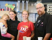 Employees Kristina Dyck (with daughter Scarlett), Ashley Krahn and manager Scott Graham were part of the team that helped raised money on Miracle Treat Day.