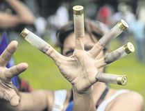 An anti-government activist shows bullet cases during a protest in Valencia, Venezuela, on Sunday, a day after a new assembly with supreme powers and loyal to President Nicolas Maduro started functioning in the country. (RONALDO SCHEMIDT/AFP/Getty Images)