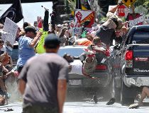 of protesters demonstrating against a white nationalist rally in Charlottesville, Va., Saturday, Aug. 12, 2017. The nationalists were holding the rally to protest plans by the city of Charlottesville to remove a statue of Confederate Gen. Robert E. Lee.
