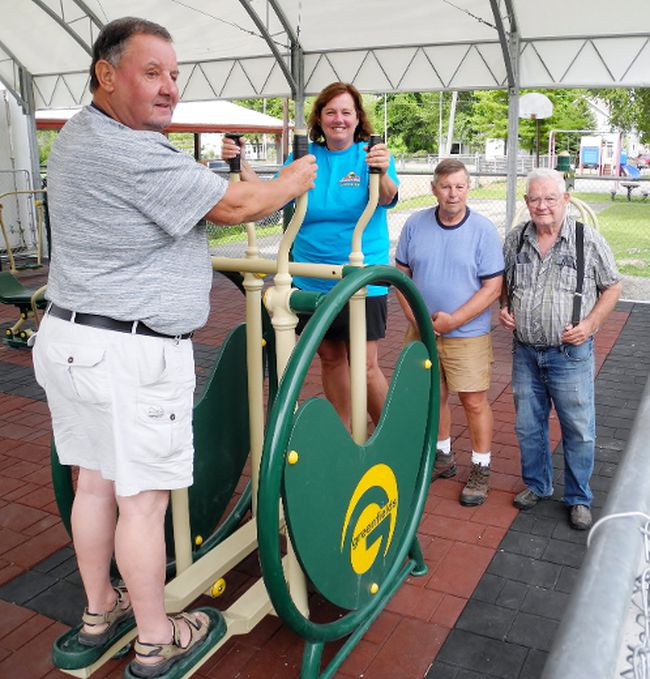 Summerfest volunteers check out the low-impact adult exercise equipment that was recently installed at the pavilion in Turkey Point. They are Larry Gardiner (left), Pauline Gibbs, Al Freeman and Norm Marshall.  MONTE SONNENBERG / SIMCOE REFORMER