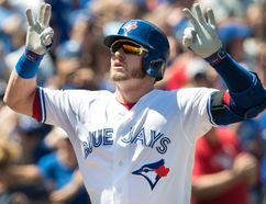 Toronto Blue Jays Josh Donaldson crosses home plate after hitting a two-run home run against the Pittsburgh Pirates in the first inning of their interleague MLB baseball game in Toronto on Sunday, August 13, 2017. (THE CANADIAN PRESS/Fred Thornhill)