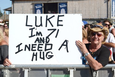 This woman was near the front of the VIP section all day Sunday, waiting for headline Luke Bryon to close out the 2017 Boots & Hearts Music Festival. Patrick Bales/Postmedia Network