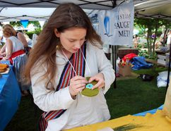 Métis artist Jenna McGuire of Lion's Head finishes up some appliqué bead work on what will become a pair of moccasins during the ninth annual Historic Saugeen Metis Rendezvous Saturday at Pioneer Park in Southampton. Denis Langlois/The Owen Sound Sun Times