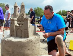 Rich Hoover works on his sandcastle Saturday afternoon during the annual Sauble Sandfest at Sauble Beach. Denis Langlois/The Owen Sound Sun Times