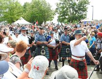 Pipers lead the crowd into the tunnel.