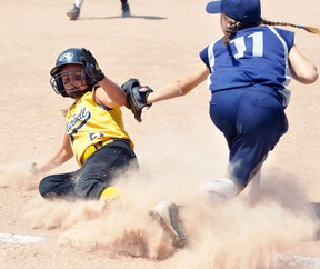 Kalea Keyser (left) of the Mitchell Squirt #2 girls team slides safely into third base during action against PDP (Plattsville-Drumbo-Princeton) in the championship game of the 'A' division in the Huron-Perth League playoff tournament Sunday, Aug. 13 in Stratford. ANDY BADER/MITCHELL ADVOCATE