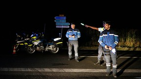 Police officers block a road approaching the town of Sept-Sorts, about 65 kilometres east of Paris, France after an incident when a driver slammed his car into the sidewalk cafe of a pizza restaurant, Monday, Aug. 14, 2017. (AP Photo/Kamil Zihnioglu)