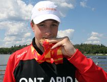 Gabe Mastromatteo bites down on his three gold, one silver medals from the 2017 Canada Summer Games in Winnipeg, during a brief return to Kenora before he left for Toronto to prepare for the 2017 FINA World Junior Championship, Aug. 23-28. SHERI LAMB/Daily Miner and News/Postmedia Network