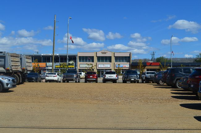 Franklin Avenue businesses are visible from a parking lot near city hall, one of the lots expropriated by the municipality in 2013, on Tuesday, August 8, 2017 in Fort McMurray, Alta. Ruth Brook/Fort McMurray Today/Postmedia Network