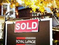 A real estate sold sign hangs in front of a west-end Toronto property, Friday, Nov. 4, 2016. The mayor of Toronto is expressing concern at the latest data on the city's hot housing market that shows home prices continue to soar. THE CANADIAN PRESS/Graeme