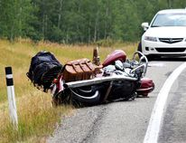 Traffic was at a halt Sunday afternoon after a bear caused vehicles to slow dramatically while taking a curve on the highway 15 minutes north of Waterton Lakes National Park. A motorcycle struck the back of a vehicle resulting in injuries. Two patients were transferred to hospital in Lethbridge. | Stephanie Hagenaars photo / Pincher Creek Echo
