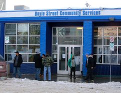 FILE - Clients stand outside the Boyle Street Community Services in December of 2013.