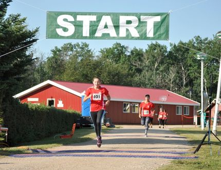 Runners prepare to cross the line at the Tri Unity Marathon south of Carrot River on Saturday, August 12, a 27 degree day.