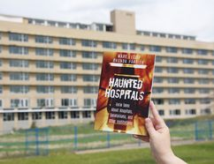 MADELEINE CUMMINGS Edmonton Examiner - Rhonda Parrish holds her new book, Haunted Hospitals: Eerie Tales About Hospitals, Sanatoriums, and Other Institutions, in front of Charles Camsell Hospital last week.