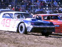 Dave Bailey, No. 49, shown rounding a turn in Hoosier Stock qualifying at Merrittville Speedway in this file photo, raced to back-to-back wins at dirt tracks in Niagara on the weekend. BERND FRANKE/Postmedia News