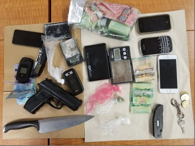 Three men were arrested in connection to a violent home invasion in Simcoe on Monday. Guns, a knife and money were among the items seized by Norfolk OPP.. NORFOLK OPP PHOTO