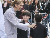 "Celine Dion is greeted by a confetti shower as she leaves the Royal Monceau Hotel with her twins Nelson and Eddy, August 10, 2017. (<A HREF=""http://www.wenn.com"" TARGET=""newwindow"">WENN.COM</a>)"