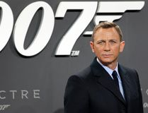 """In this Oct. 28, 2015, file photo, actor Daniel Craig poses for the media as he arrives for the German premiere of the James Bond movie 'Spectre' in Berlin, Germany. Craig announced on """"The Late Show with Stephen Colbert"""" Aug. 15, 2017, that he would return as the British super spy in 2019's """"Bond 25."""" (AP Photo/Michael Sohn, File)"""