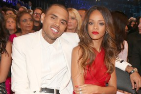 Chris Brown (L) and Rihanna attend the 55th Annual GRAMMY Awards at STAPLES Center on February 10, 2013 in Los Angeles, California. (Photo by Christopher Polk/Getty Images for NARAS)