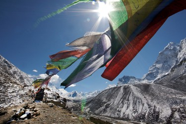 Buddhist prayer flags flap in the breeze on a day hike near Dingboche.