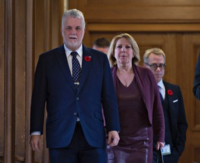 Quebec Premier Philippe Couillard, left, and Christine St-Pierre, Quebec minister of International Relations and La Francophonie walk to a news conference to react to the election of Donald Trump, before heading to a party caucus meeting, Wednesday, November 9, 2016 at the legislature in Quebec City. (THE CANADIAN PRESS/Jacques Boissinot)