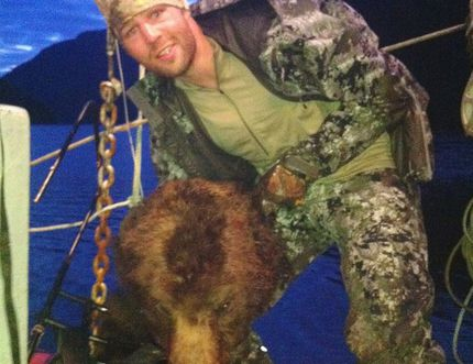 Clayton Stoner, an NHL player for the Minnesota Wild, holding up a grizzly bear head in this photo taken in May and released to media on September 3. (Courtesy Coastal First Nations)