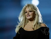 """In this May 17, 2013, file photo, Bonnie Tyler performs her song """"Believe in Me"""" during a rehearsal for the final of the Eurovision Song Contest at the Malmo Arena in Malmo, Sweden. Royal Caribbean announced on Aug. 16, 2017, that Tyler will perform her hit """"Total Eclipse of the Heart"""" at sea on the day of the total eclipse Monday during a """"Total Eclipse Cruise."""" (AP Photo/Alastair Grant, File)"""