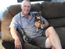 Todd Bertrend is pictured at home with his dog Coco. (Wayne Lowrie/The Recorder and Times)