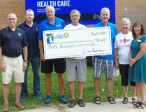 Cheques representing proceeds of the Rotary Huron Shore Run were distributed to recipients Aug. 12 in Southampton, On hand were Rotary President Dan Murawsky (left), Saugeen Track and Field Club official Rick Carr, Southampton Rotary President Ed Braun, Run organizer John Van Bastelaar, Saugeen Memorial Hospital Foundation Chair Jim Barbour, Run organizer June Van Bastelaar and Foundation Executive Director Sally Kidson. Frances learment/Shoreline Beacon