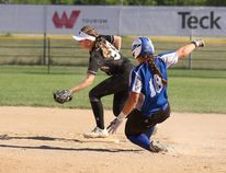 Photo by Darryl Gershman - Becki Monaghan (right) slides into second base in Canada Summer Games competition. The Spruce Grove product left from the Games to the University of Kansas to play for the Jayhawks women's softball team.