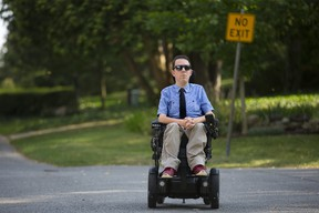 There are no sidewalks in Jeff Preston's neighbourhood in London. A parked car on a street forces him into the dangerous position of having to drive his wheelchair around it and into the middle of the road. During winter months, he is unable to travel in his chair at all. Derek Ruttan/The London Free Press/Postmedia Network